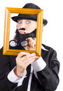 Woman looking through frame a in fake beard and men s clothes an empty picture Stock Photos
