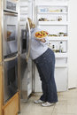 Woman Looking Into Fridge Royalty Free Stock Images