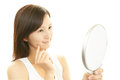 Woman looking at herself in a hand mirror beautiful young Stock Photos