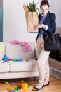 Woman looking at the mess in the room returned home from shopping and Royalty Free Stock Photography