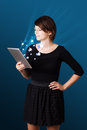 Woman looking at modern tablet with social icons Royalty Free Stock Images