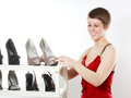 Woman looking a nice shoes happy smiling young at Stock Image