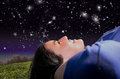 Woman looking at night sky concept about relax and joy Stock Photography