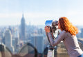 Woman looking in observation binoculars. Royalty Free Stock Photo