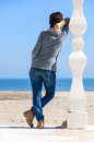 Woman looking at ocean back view brunette on beach white column support Royalty Free Stock Photography