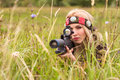 Woman looking into the optical sight Royalty Free Stock Photo