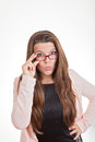 Woman looking over top of glasses Royalty Free Stock Photo