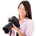 Woman looking at pictures on the camera a digital isolated over white Royalty Free Stock Image