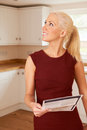 Woman Looking At Property Details In New Home Royalty Free Stock Photo