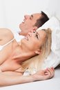 Woman looking at snoring man portrait of an angry awaken by her boyfriend s Stock Photography