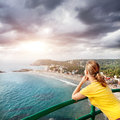 Woman looking to the ocean beach and from lighthouse at overcast sky in kovalam kerala india Stock Photography