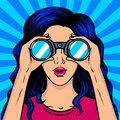 Woman looks through binocular pop art vector