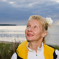 Woman looks at a cloudy sky the sea Royalty Free Stock Photography