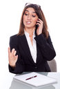 Woman looks a fingernail beautiful and talking on the phone Royalty Free Stock Image