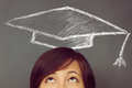 Woman looks up on drawing educational hat young the background of blackboard concept of education Royalty Free Stock Photography
