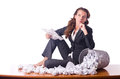 Woman with lots of discarded paper Stock Photography