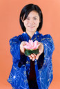 Woman with lotus blossom Stock Photos