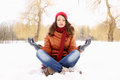 Woman in a lotus position young girl pose the snow Stock Photography