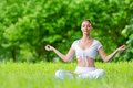 Woman in lotus position zen gesturing with closed eyes sits concept of healthy lifestyle and relaxation Stock Photography