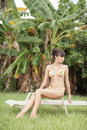 Woman lounging in the tropics Stock Photography