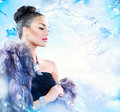 Woman in luxury fur coat winter beauty fashion model girl Royalty Free Stock Images