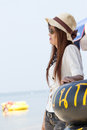 Woman in luxury hat looking to the sea at chonburi thailand Royalty Free Stock Photo