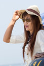 Woman in luxury hat looking to the sea at chonburi thailand Stock Image