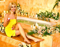 Woman at luxury spa blonde relaxing flower water Royalty Free Stock Photos