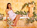 Woman at luxury spa relaxing flower water Stock Images
