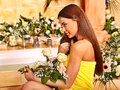 Woman at luxury spa relaxing flower water Stock Photography