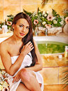 Woman at luxury spa relaxing water Stock Photos