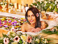 Woman at luxury spa relaxing water Stock Images