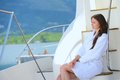 Woman on luxury yacht lies a in the sea and looking to the horizon Royalty Free Stock Images