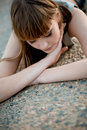 Woman lying on asphalt Royalty Free Stock Photography