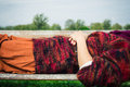 Woman lying on a bench relaxing Royalty Free Stock Photo