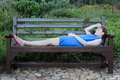 Woman lying on a Bench very tired Royalty Free Stock Photo