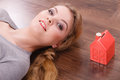 Woman lying with cash box. Royalty Free Stock Photo