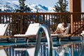 Woman lying at the pool in bikini in the snowy mountains Royalty Free Stock Photo