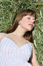 Woman lying in dry grass Stock Photo