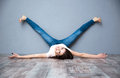 Woman lying on the floor with legs raised up funny beautiful Royalty Free Stock Photo