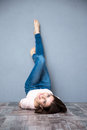 Woman lying on the floor with legs raised up happy cute Royalty Free Stock Images
