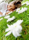 Woman lying on a floral garden Royalty Free Stock Photo