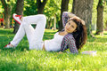 A woman lying on the grass in plaid shirt Royalty Free Stock Photography