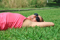 Woman lying in grass Royalty Free Stock Photo
