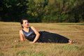 Woman lying in grass smiling happy beautiful girl summer relaxing Royalty Free Stock Images