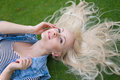 Woman lying on the green grass with untressed hair Royalty Free Stock Photo