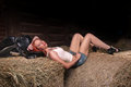 image photo : Woman lying on a haystack
