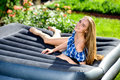 Woman lying on the mattress in the garden happy young Royalty Free Stock Photo