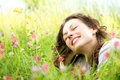 Woman lying in Meadow of Flowers Royalty Free Stock Photography