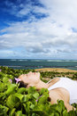 Woman Lying in Plants Near Beach Royalty Free Stock Photos